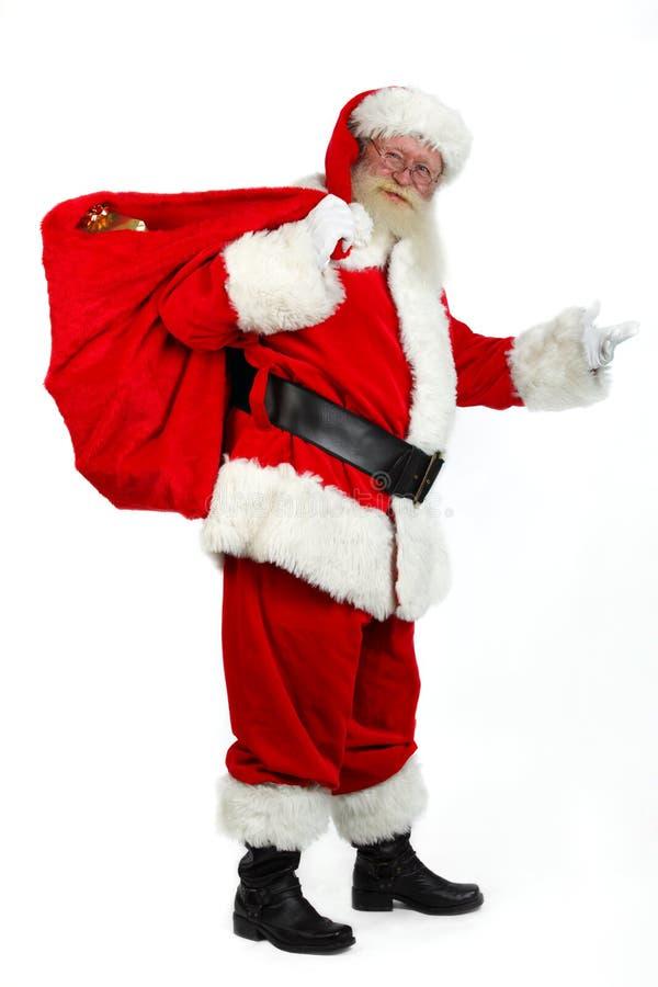 Santa che porta i presente fotografie stock