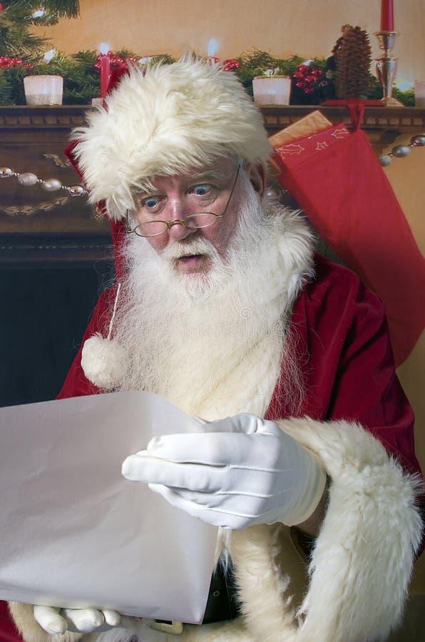 Santa checking his list stock photography