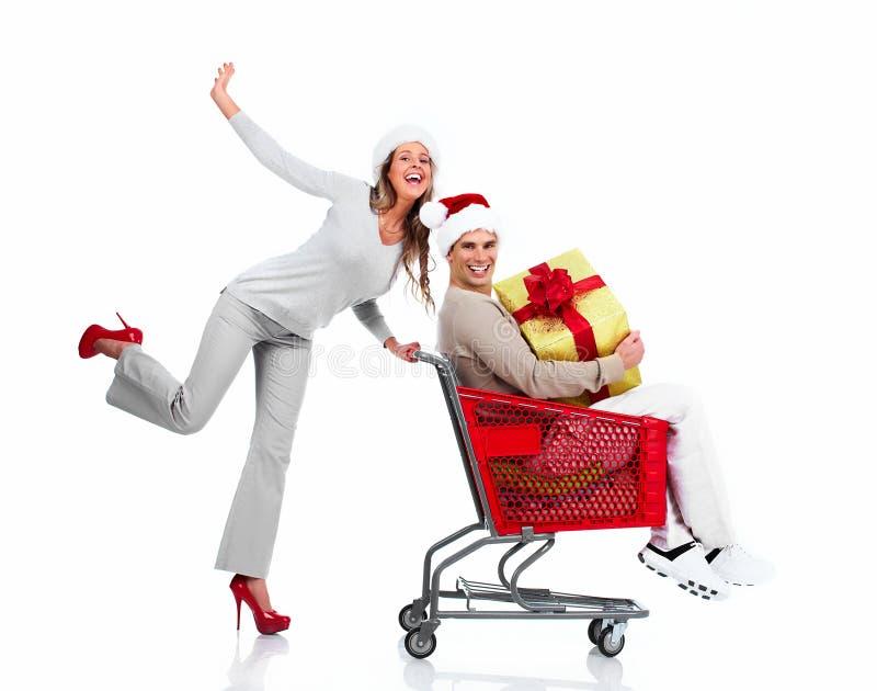 Santa Christmas-Paare mit einem Geschenk lizenzfreies stockfoto