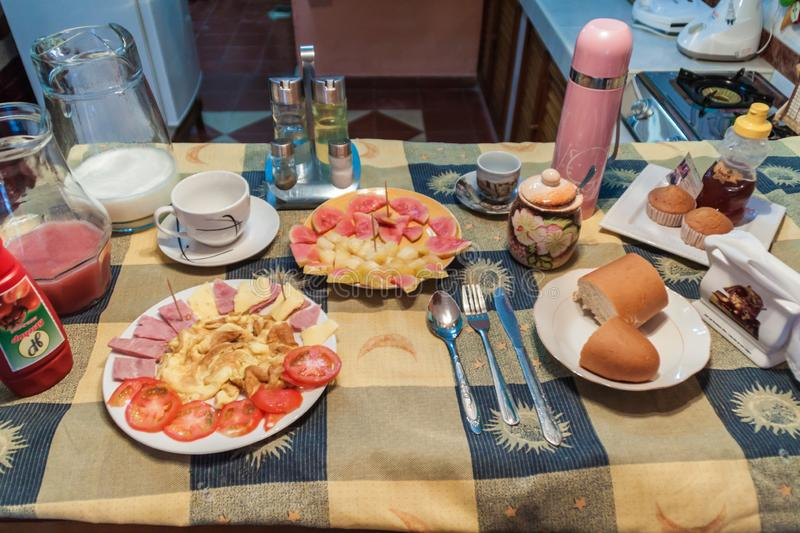 SANTA CLARA, CUBA - FEB 14, 2016: Breakfast in a rental room for tourists casa particular in Santa Clara, Cub. A stock image