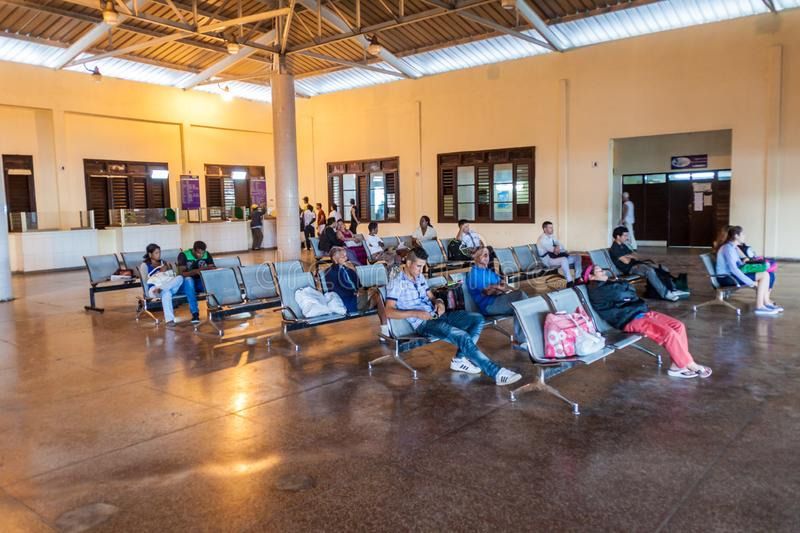 SANTA CLARA, CUBA - FEBRUARY 12, 2016: People wait at a bus station in Santa Clara, Cub stock images
