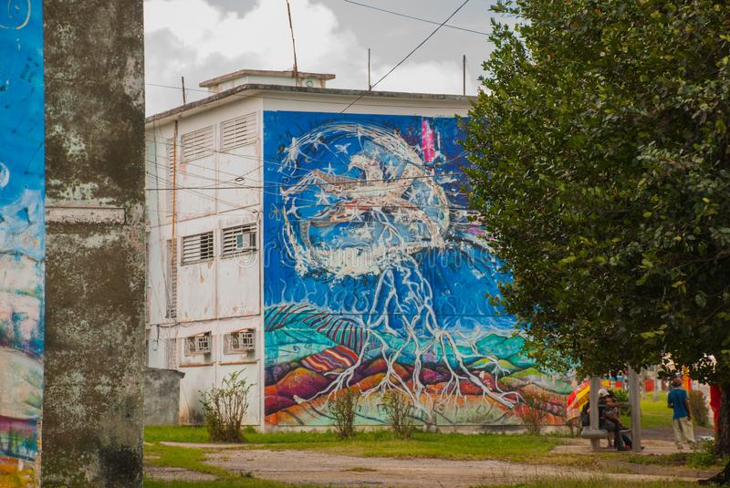 Santa Clara, Cuba: The house on which the drawing is made paints. Graffiti on the building. stock photo