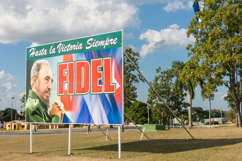 Poster with image of Fidel Castro and Cuban flag in Santa Clara, Cuba. SANTA CLARA, CUBA-JANUARY 14, 2017: `Hasta la victoria siempre`. Slogan of the Cuban royalty free stock photo