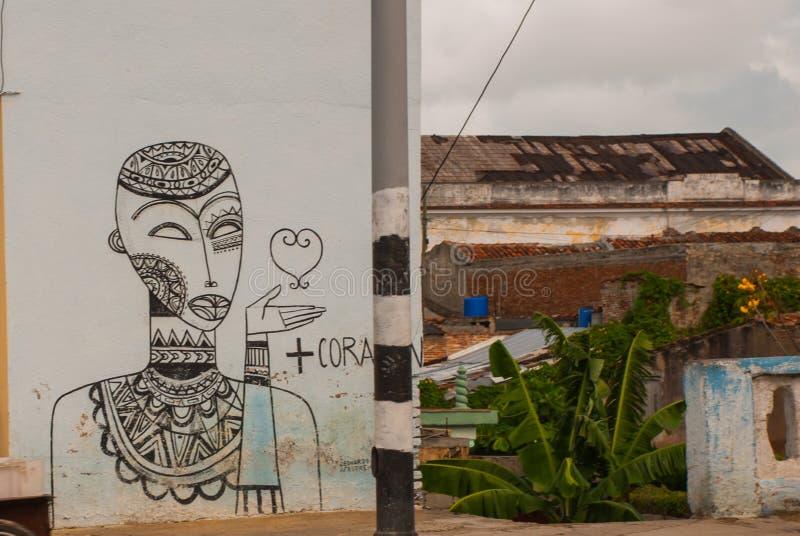 Santa Clara, Cuba : La maison sur laquelle le dessin est fait peint Graffiti sur le bâtiment photos stock