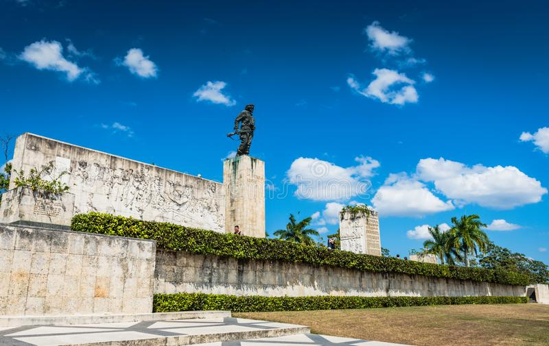 Che Guevara Monument and Mausoleum. Santa Clara, Cuba / March 16, 2016: Bronze statue of revolutionary military leader Che Guevara atop large monument stock photography