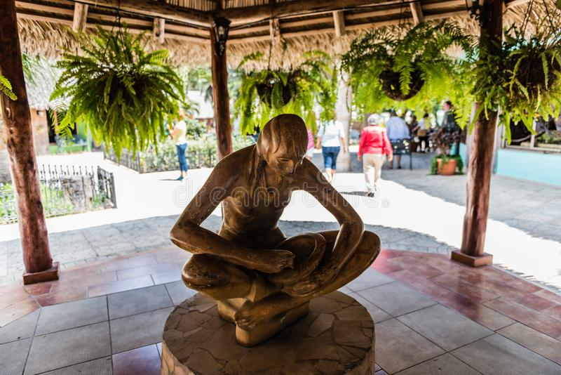 Female Taino Statue - Las Caneyes. Santa Clara, Cuba / March 16, 2016 Sculpture of indigenous femaie at Hotel Las Caneyes royalty free stock images