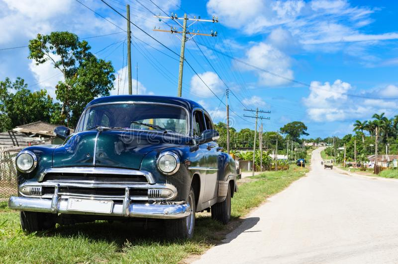 American black 1951 vintage car on the country road in Quintin Banderas to the city Santa. Clara in Cuba - Serie Cuba Reportage royalty free stock photography