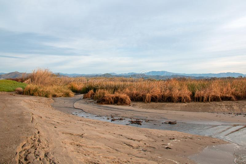 Santa Clara river estuary with lowering water level at the river mouth at morning in Ventura California USA. Santa Clara river estuary with lowering water level royalty free stock photo