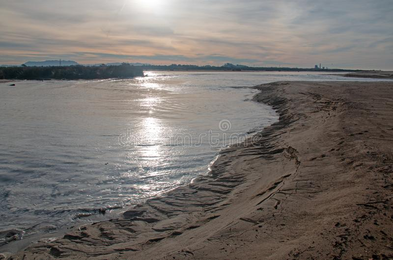 Santa Clara river estuary with lowering water level at the river mouth at sunrise in Ventura California USA. Santa Clara river estuary with lowering water level stock images