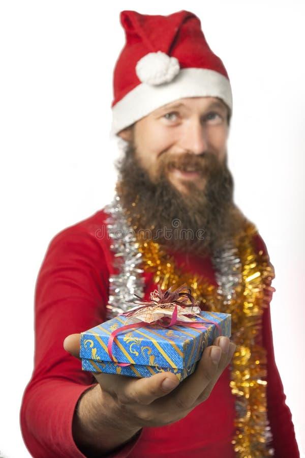 Santa Claus дает подарок стоковое фото
