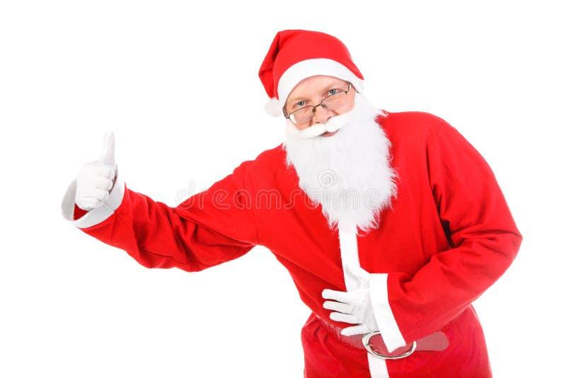 Santa Claus с большим пальцем руки вверх стоковое фото rf