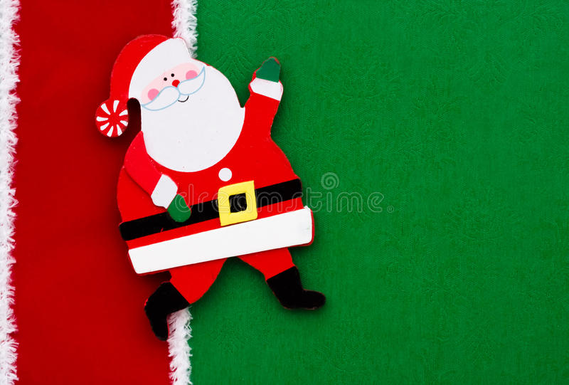 Santa Claus. A santa claus on a green background with red ribbon stock images