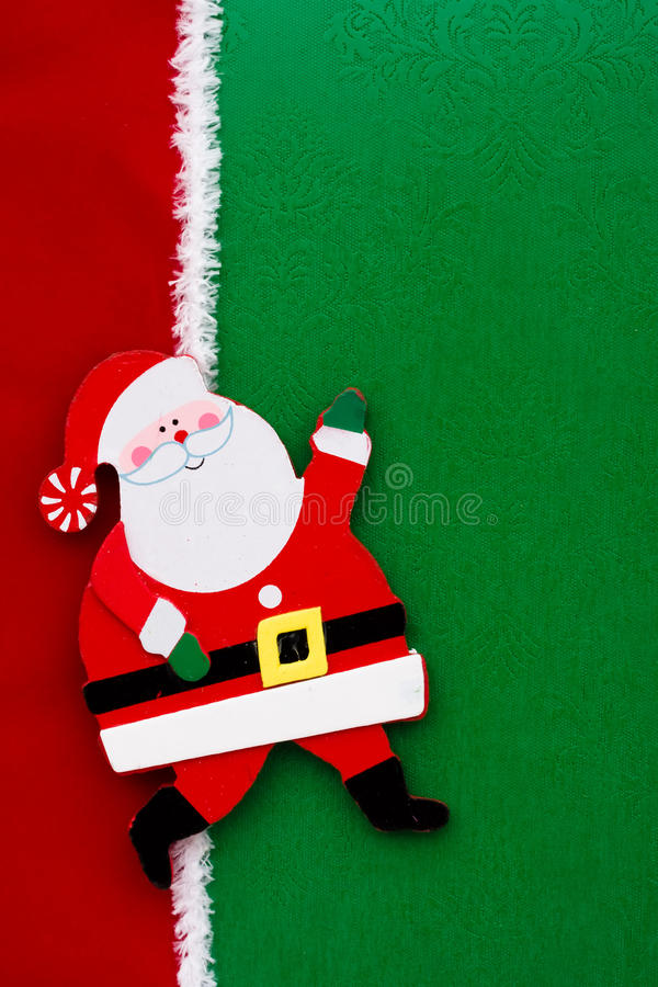 Santa Claus. A santa claus on a green background with red ribbon royalty free stock image
