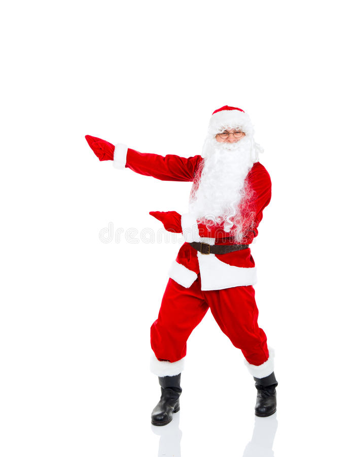Santa Claus. Holding Banner point finger glove at blank empty copy space for Text isolated over white background royalty free stock images