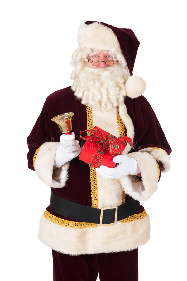 Santa Claus. The real Santa Claus with present and bell royalty free stock image