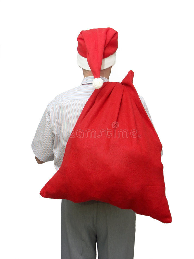 Santa Claus. Man wearing santa claus cap with big red bag full of Xmas presents put on his shoulder stock image