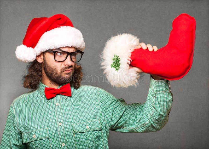 Santa Claus alla moda sta guardando gli stivali di Natale fotografia stock libera da diritti