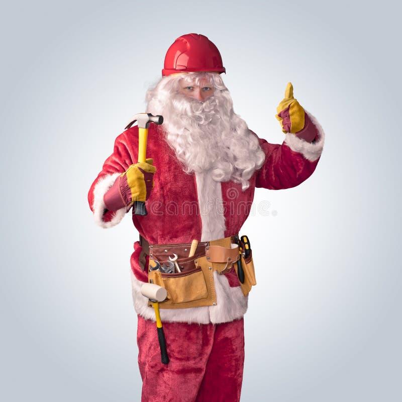 Santa Claus arbetare i hjälm med hammaren royaltyfria foton