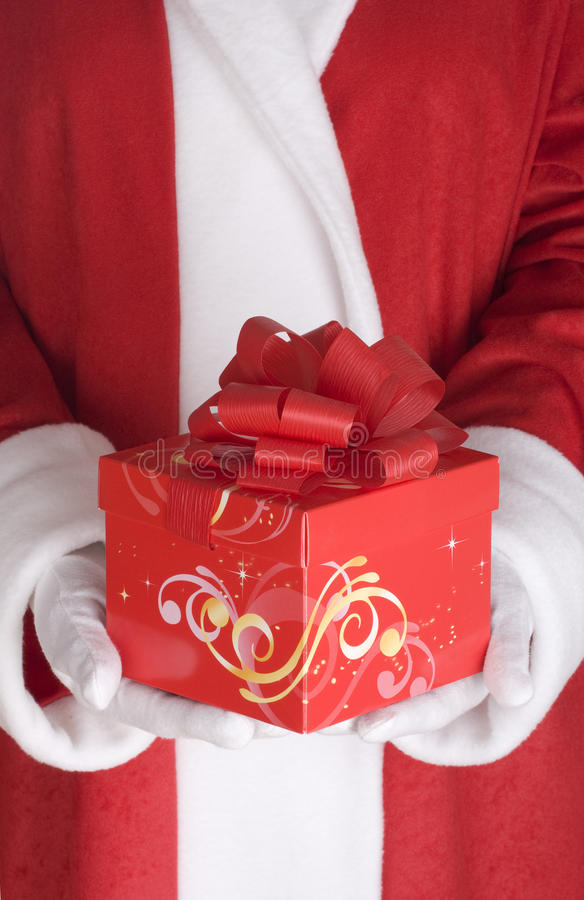 Download Santa Claus Arm With Present Stock Image - Image: 24053249