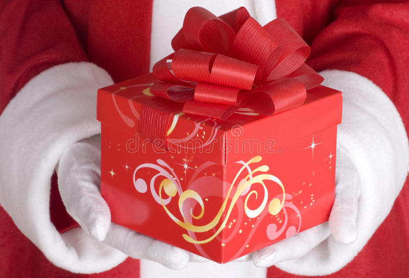Download Santa Claus Arm With Present Royalty Free Stock Photo - Image: 24053255