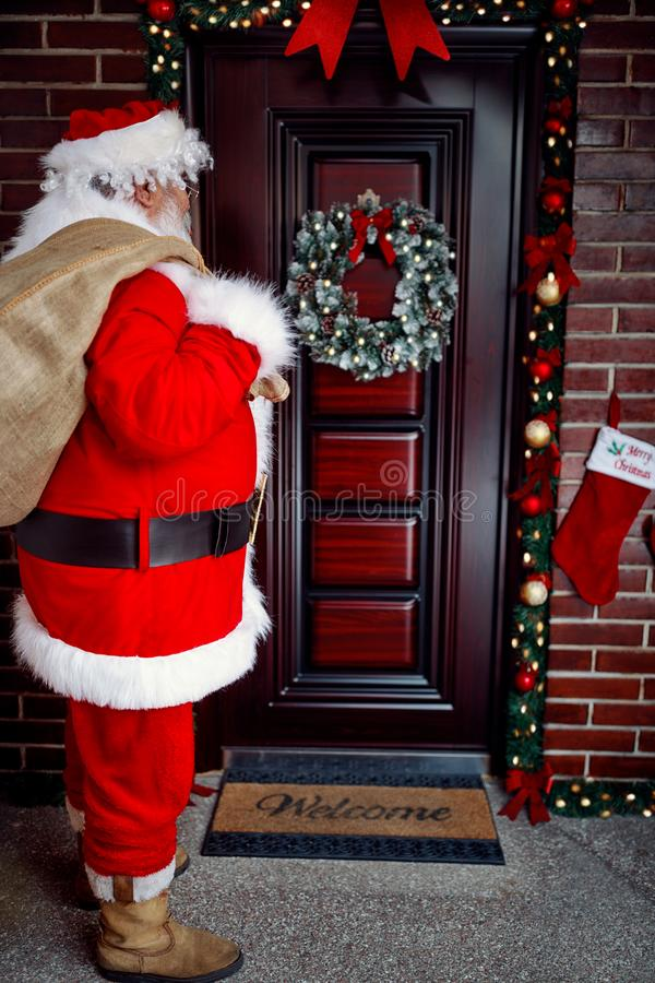 Santa Claus arrives with present on large bag at in night royalty free stock images