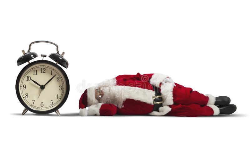 Santa Claus asleep. Concept of tired Santa Claus asleep lying on the ground stock images
