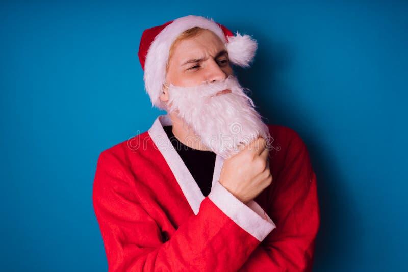 Santa Claus auf einem blauen Hintergrund Guten Rutsch ins Neue Jahr und frohe Weihnachten! lizenzfreies stockfoto