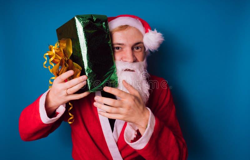 Santa Claus auf einem blauen Hintergrund Guten Rutsch ins Neue Jahr und frohe Weihnachten! lizenzfreies stockbild