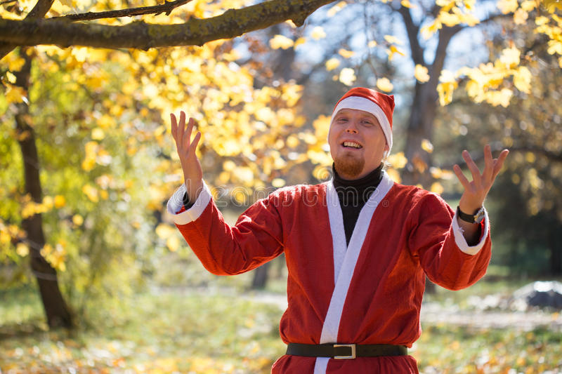 Santa Claus in autumnal park stock photo