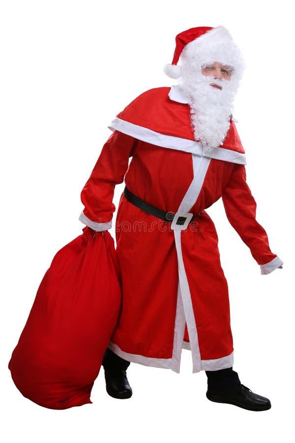 Santa Claus avec le sac pour le présent de cadeau de cadeaux de Noël d'isolement image libre de droits