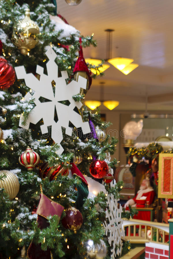 Download Santa Claus In Background Behind Christmas Tree Royalty Free Stock Images - Image: 23527329