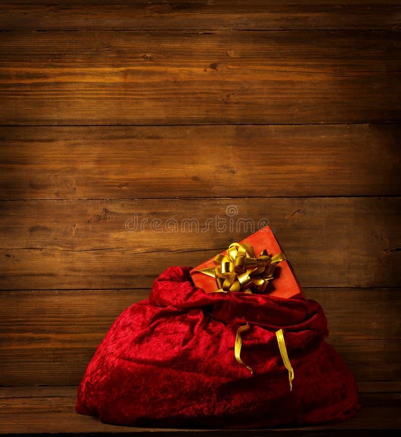 Santa Claus Bag, Christmas Red Sackful, Brown Wooden Background stock photos