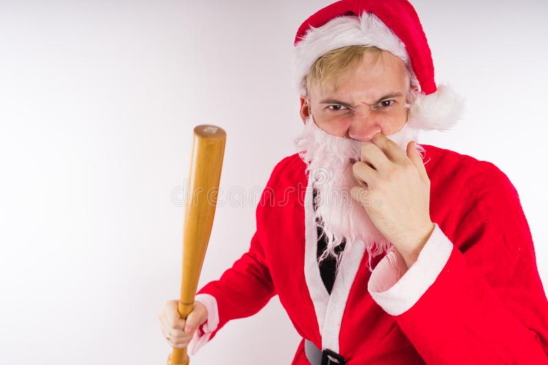 Santa Claus with a baseball bat, the concept of an evil Santa Claus for Christmas stock photography