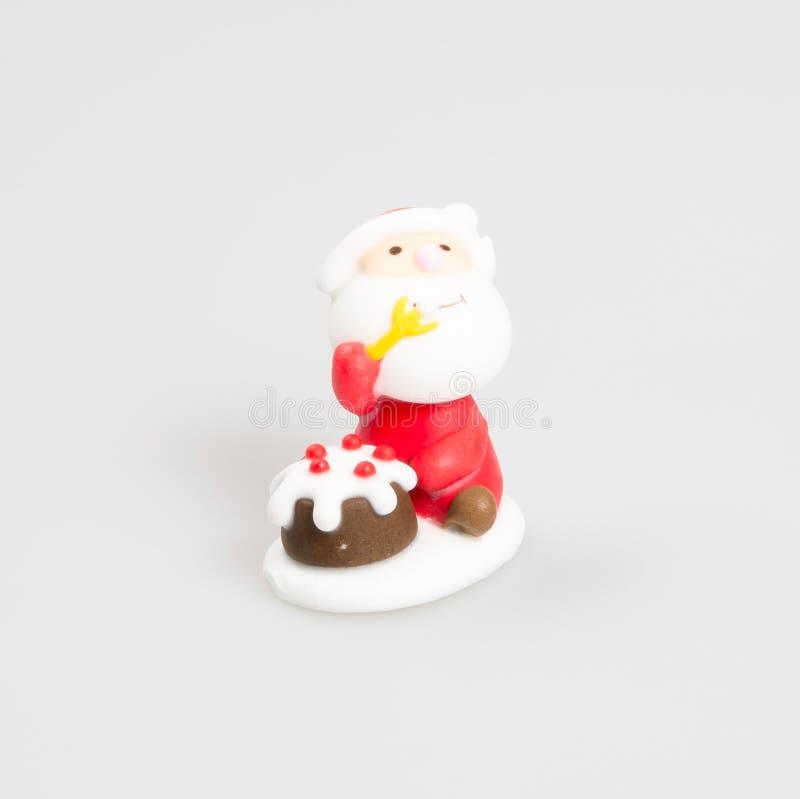 Santa Claus-beeldje of Santa Claus op een achtergrond stock fotografie