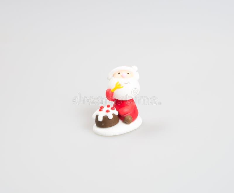 Santa Claus-beeldje of Santa Claus op een achtergrond stock afbeelding