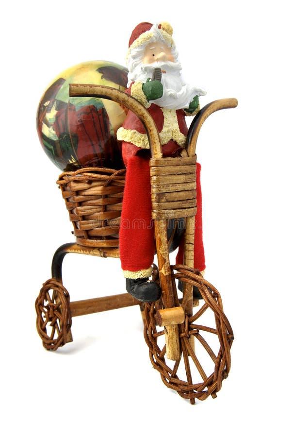 Santa claus in bicycle royalty free stock photos