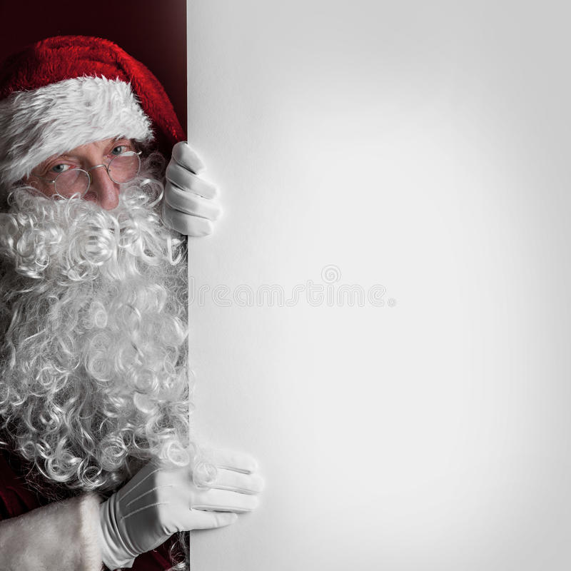 Santa Claus with big blank card stock image