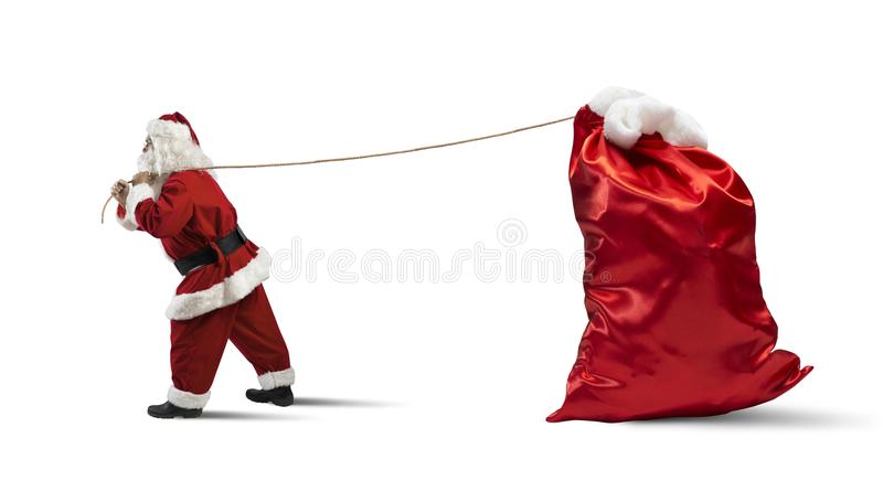 Santa Claus with big sack. Santa Claus pulls a big sack full of presents royalty free stock photography