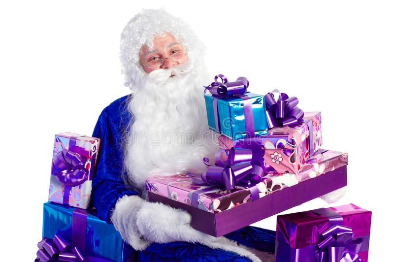 Santa Claus in blue with presents stock photos