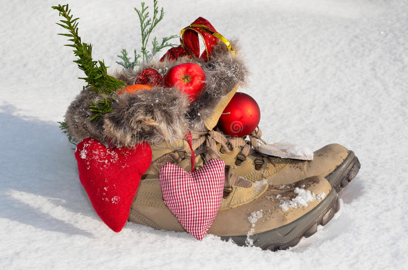 Santa Claus Boots in the snow royalty free stock images