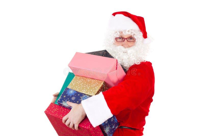 Santa Claus bringing some gifts royalty free stock photo