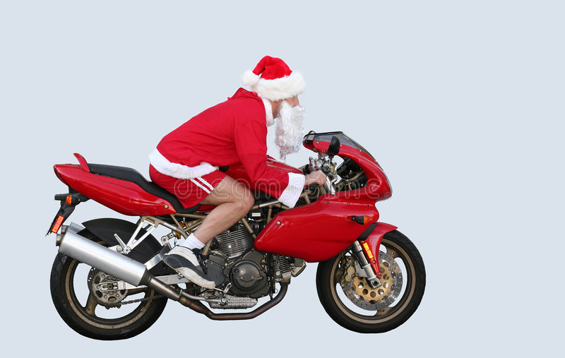 Santa Claus in CA. Santa Claus on a motorcycle in CA royalty free stock images