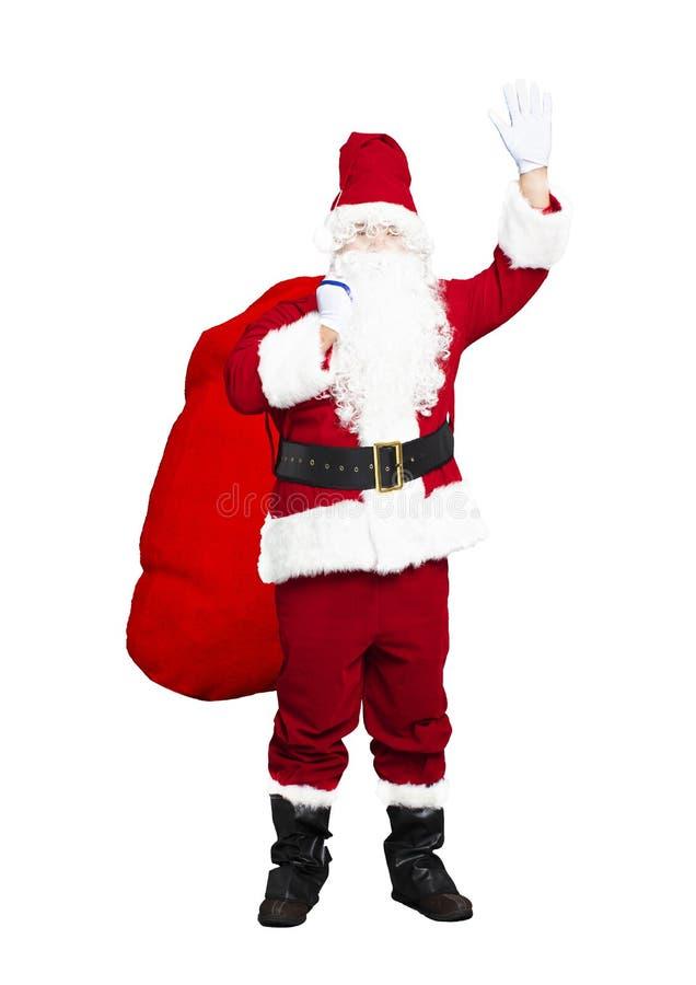 Santa Claus carrying big bag. Isolated stock photos