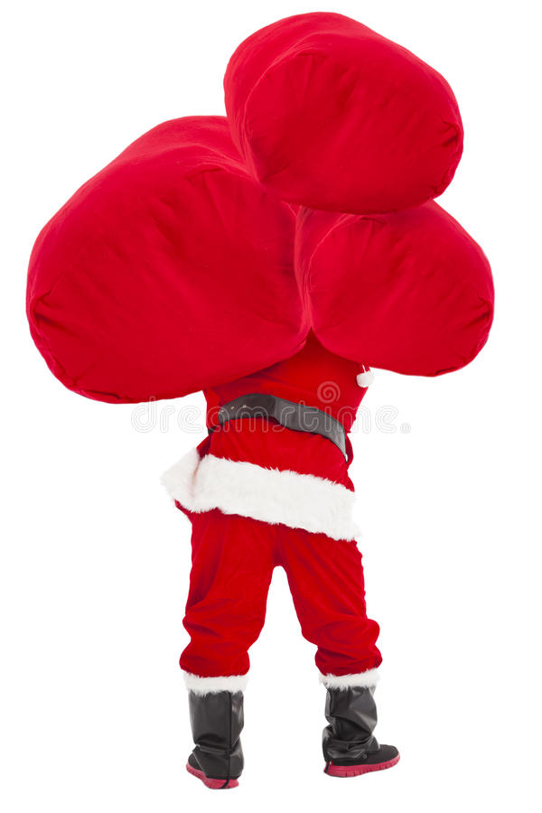 Santa claus carrying heavy gift bag. Isolated royalty free stock photo