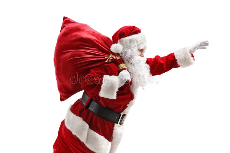 Santa Claus carrying a sac and gesturing with hand stock images