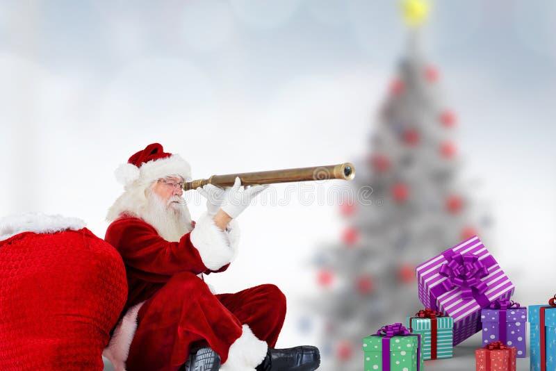 Santa Claus che guarda tramite il binocolo fotografia stock