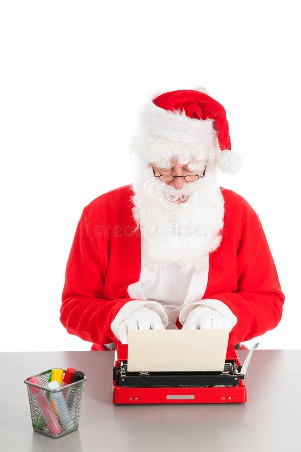 Santa Claus che scrive una lettera fotografia stock libera da diritti