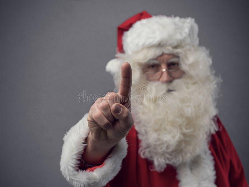 Santa Claus che usando un'interfaccia utente del touch screen immagine stock libera da diritti