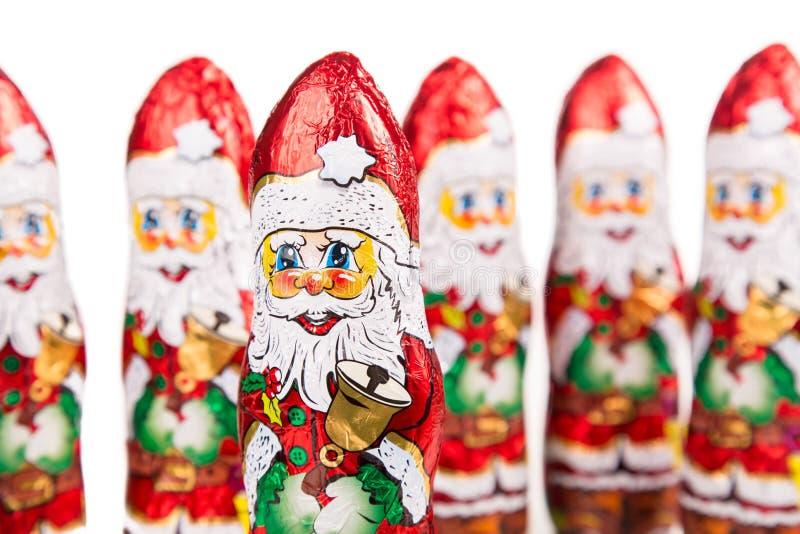 Santa Claus chokladdiagram xmas för bana för clippinggarnering hjortar isolerad röd royaltyfri bild