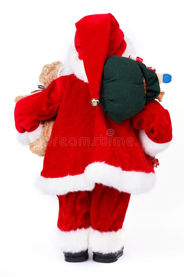 Santa Claus with Christmas gifts, back view. royalty free stock image